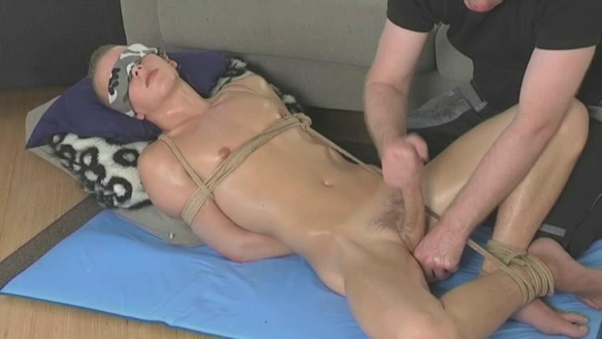 Tied beside twink getting his dick stroked