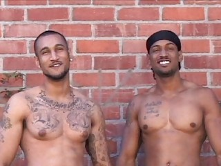 Two tattooed latin gays posing naked outdoor