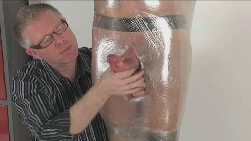 Gay fella with hard dick gets predestined and wrapped like a mummy