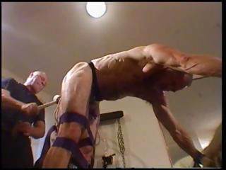 Lady's man is tied connected with and bent over with his master abusing his ass