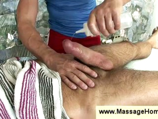 Gay masseur stroking hairy man